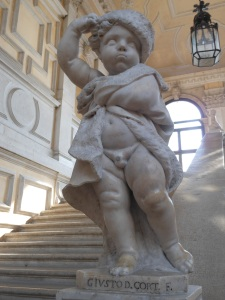 A cherub dressed as Winter greets guests on the main staircase